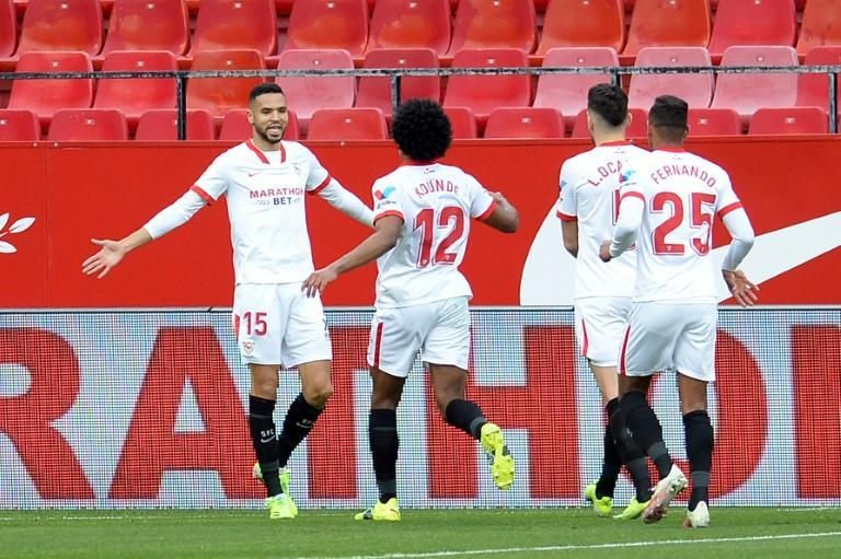 Youssef en-Nesyri (L) celebrates one of his three La Liga goals for Sevilla against Cadiz