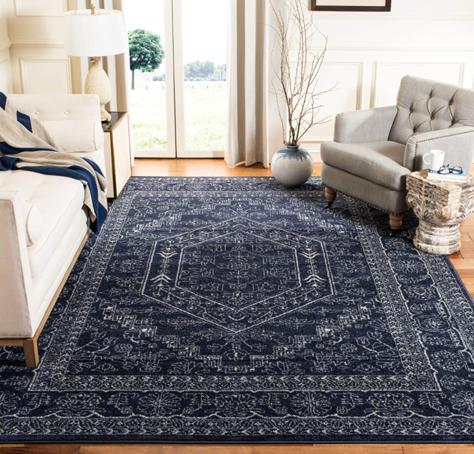 Safavieh Adirondack Collection Oriental Vintage Area Rug in Navy/Ivory (Photo via Amazon)