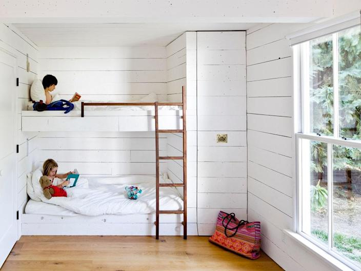 In the tiny house, custom bunk beds and a pull-out closet help optimize the space.