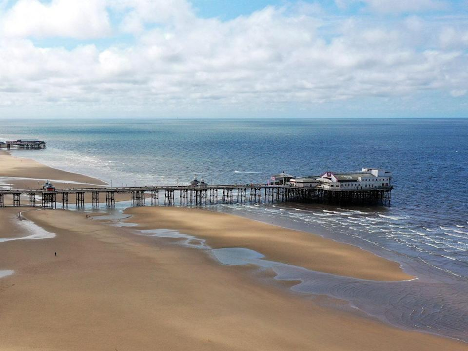 Alex Gibson, 22, jumped into the water close to the North Pier in Blackpool at around 4.20am on Friday morning (AFP/Getty)