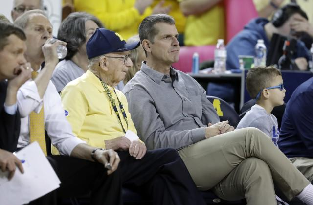 Michigan coach Jim Harbaugh (R) has his team in Rome. (AP Photo/Carlos Osorio)