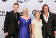 Brian Kelley (L) and Tyler Hubbard (R) of Florida Georgia Line and their guests arrive at the 47th Country Music Association Awards in Nashville, Tennessee November 6, 2013. REUTERS/Eric Henderson (UNITED STATES - Tags: ENTERTAINMENT)