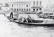<p>Paul McCartney and his wife, Linda, seated in the back of a gondola as they and other members of McCartney's band Wings ride on a canal before their concert in St. Mark's Square in Venice in 1976.</p>