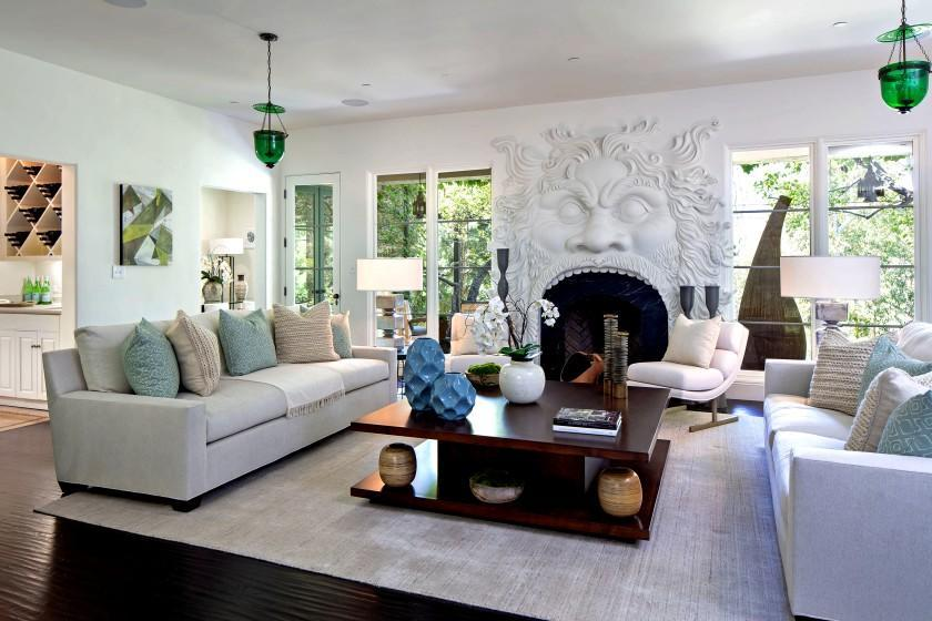 Geena Davis' Pacific Palisades home, full of white walls and soothing hues, opens to a living room with a sculptural fireplace. Listed for $5.995 million, the Mediterranean-style home has five bedrooms, an office and an updated kitchen.