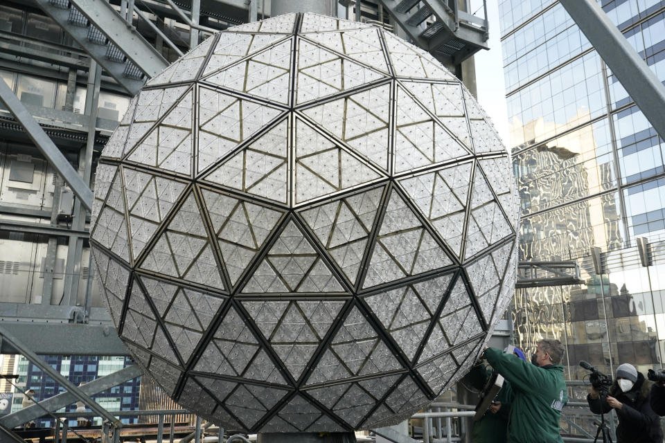 A member of the media films workers installing a panel of Waterford crystal triangles on the Times Square New Year's Eve ball, Sunday, Dec. 27, 2020, in New York. (AP Photo/Kathy Willens)