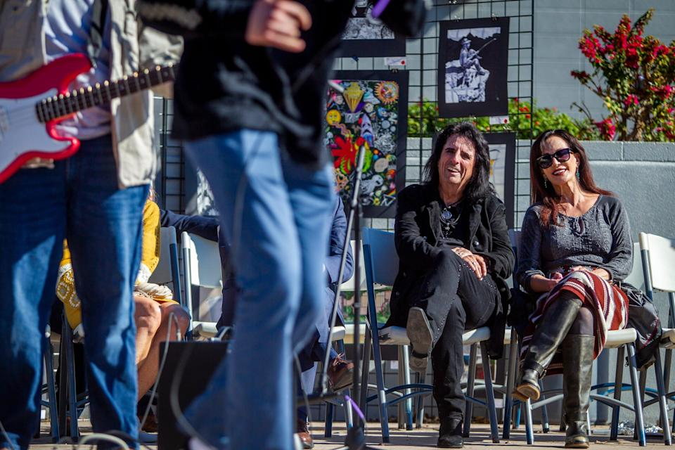 Alice Cooper and Sheryl Cooper listen to a student rock band after announcing a new Solid Rock Teen Center in Mesa during an event at Westwood High School on Jan. 22, 2020.