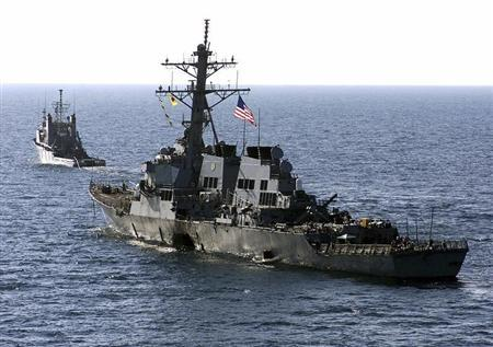 Military U.S. Navy destroyer USS Cole is towed away from port city of Aden, Yemen, into open sea by Military Sealift Command ocean-going tug USNS Catawba