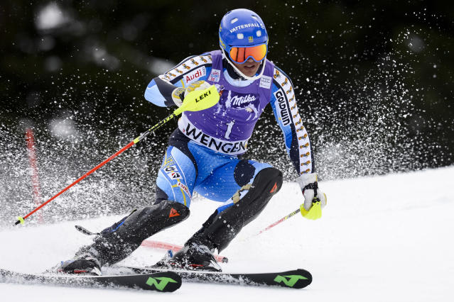 Andre Myhrer of Sweden clears a gate during the first run of the men's Alpine skiing slalom World Cup race at the Lauberhorn in Wengen, Switzerland, Sunday, Jan. 19, 2014. (AP Photo/Keystone, Jean-Christophe Bott)