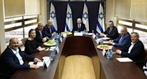 Party leaders of the proposed new coalition government, pose for a picture at the Knesset, Israel's parliament, before the start of a special session to approve and swear-in the coalition government, in Jerusalem
