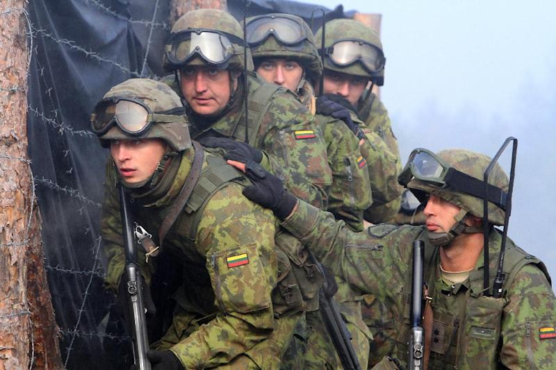 Lithuanian soldiers take part in NATO-led military exercises near Vilnius in September 2012