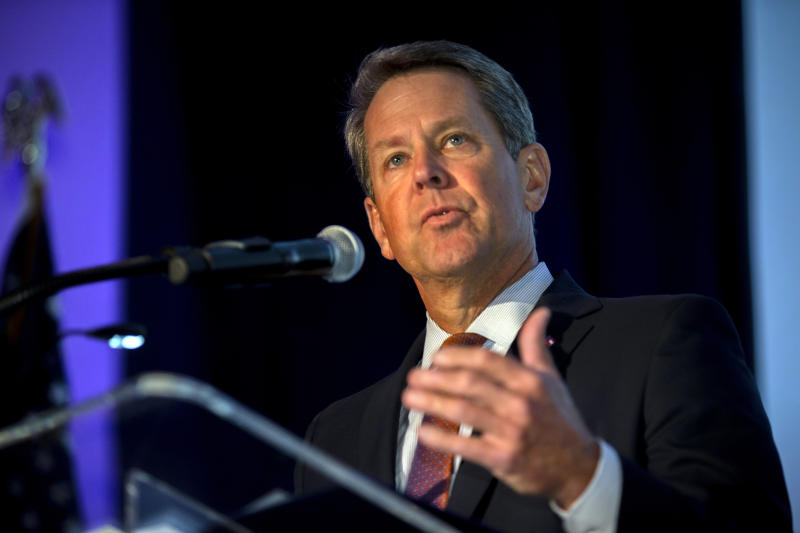 In this image provided by the Georgia Port Authority, Georgia Gov. Brian Kemp speaks during the Georgia Ports Authority's Savannah State of the Port event, Thursday, Sept. 12, 2019, in Savannah, Ga. The GPA plans to double capacity at Garden City Terminal to 11 million twenty-foot equivalent container units per year. In Fiscal Year 2019, port-related industries announced $5 billion in new investment and 12,000 new jobs coming to Georgia. (Stephen Morton/Georgia Port Authority via AP)
