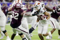 Texas A&M defensive lineman Jayden Peevy (92) snags Oklahoma State running back Chuba Hubbard (30) for a tackle during the second half of the Texas Bowl NCAA college football game Friday, Dec. 27, 2019, in Houston. (AP Photo/Michael Wyke)