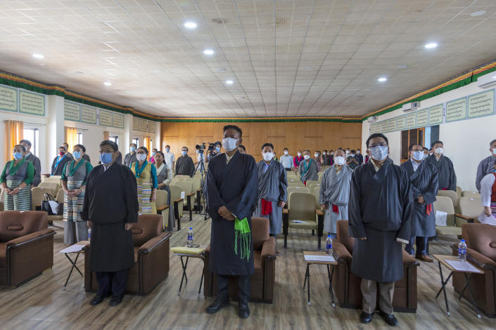 President of the Central Tibetan Administration Penpa Tsering, center front, stands up with other government officials for the Tibetan national anthem during a ceremony to mark the 86th birthday of their spiritual leader the Dalai Lama in Dharmsala, India, Tuesday, July 6, 2021. (AP Photo/Ashwini Bhatia)