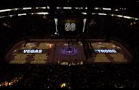 <p>The names of the 58 victims are projected on the ice during the 58 seconds of silence before the game. (Ethan Miller/Getty Images) </p>
