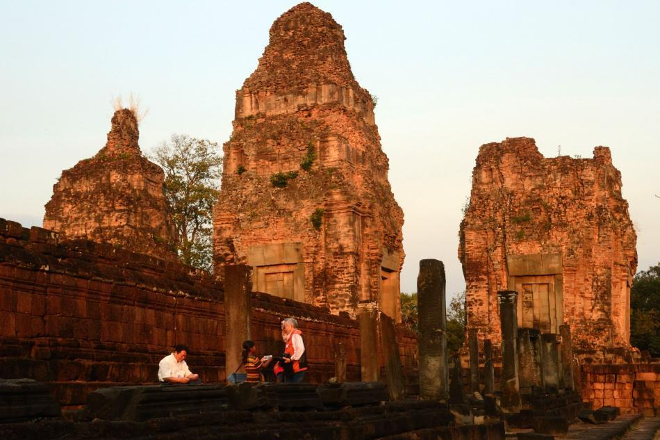 The guides and the tuk tuk guys will highly recommend Pre Rup for the sunset and I found it rather quiet compared to the other sunset points This state temple is built a few kilometers away from Angkor town and stands on the way to Banteay Srei. The towers, built in laterite, sandstone and brick, glow in the evening sun as we spend a few quiet moments before returning to Siem Reap.