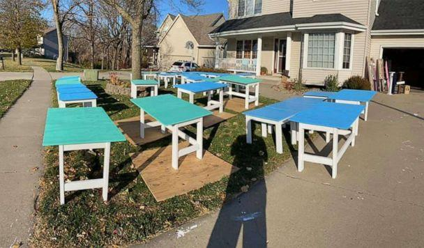 PHOTO: Nate Evans, a 7th grade literacy teacher from Ankeny, launched the project he calls Woodworking with a Purpose. He and 50-plus volunteers have built roughly 600 desks for kids. Each desk cost $20-$25 to make. (Nate Evans)