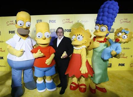 Groening, creator of The Simpsons, poses with characters from the show at the 20th anniversary party in Santa Monica