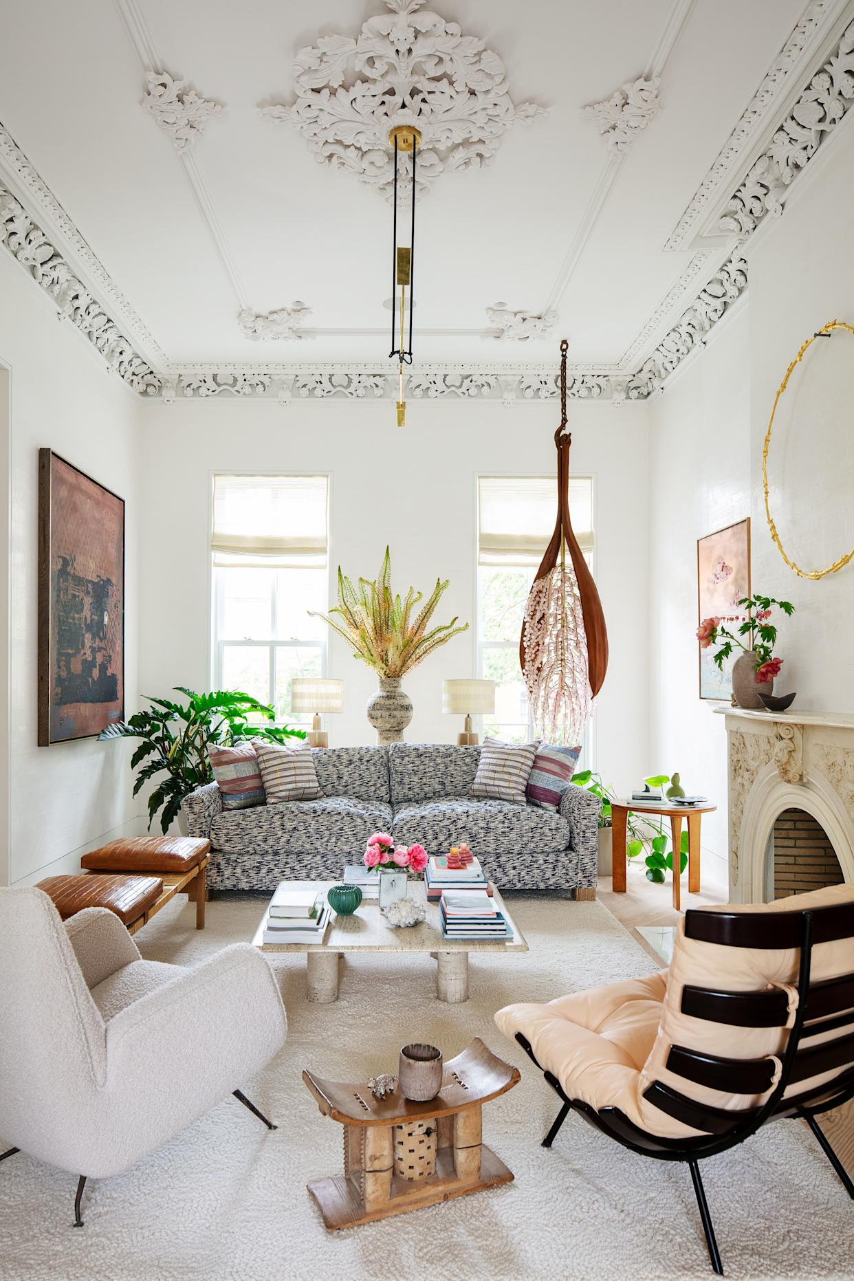 """<div class=""""caption""""> The living room's bespoke sofa wears a nubby abstract ikat handwoven in California. </div>"""