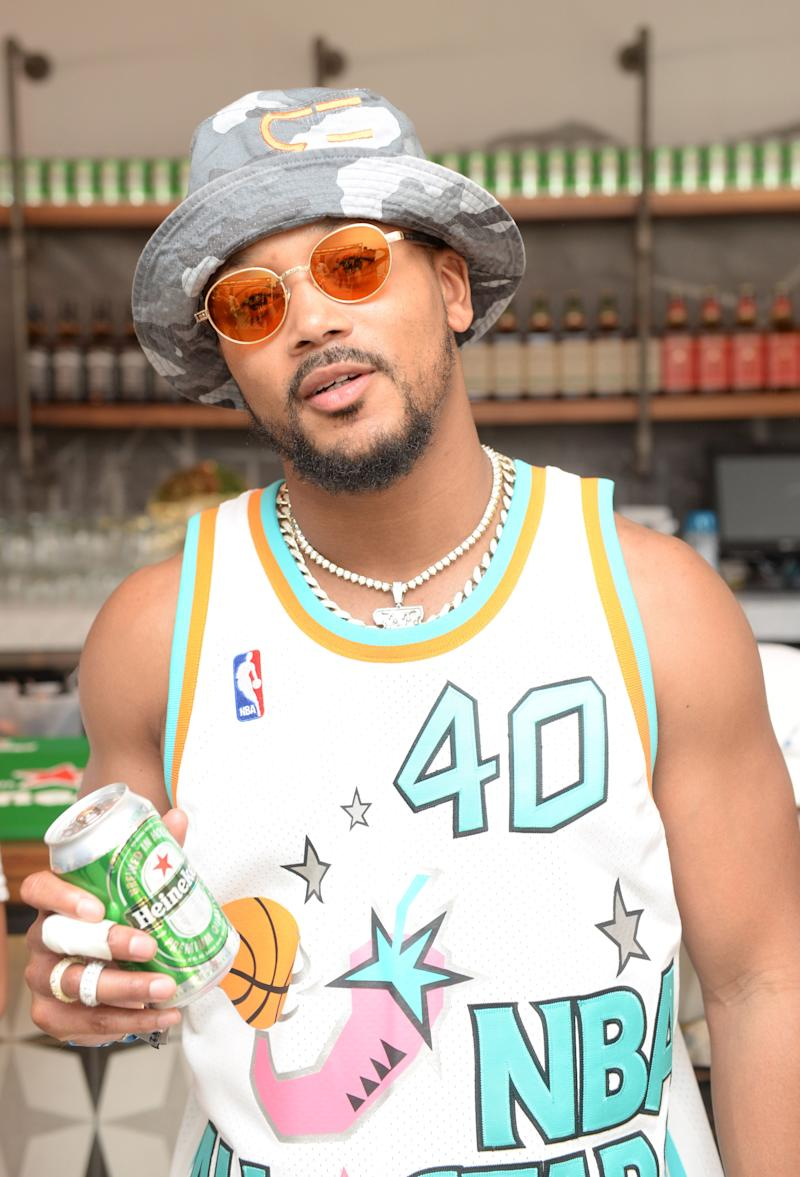 Romeo Miller poses for a photo