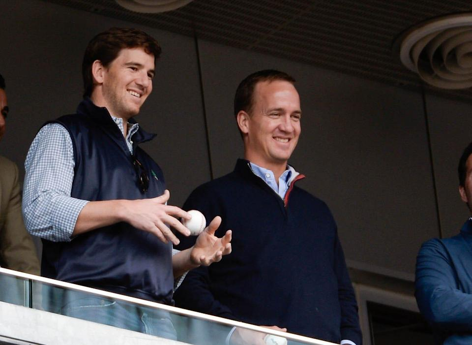 It surely appears former NFL QBs Eli Manning, left, and brother Peyton Manning have a rosy future in broadcasting.