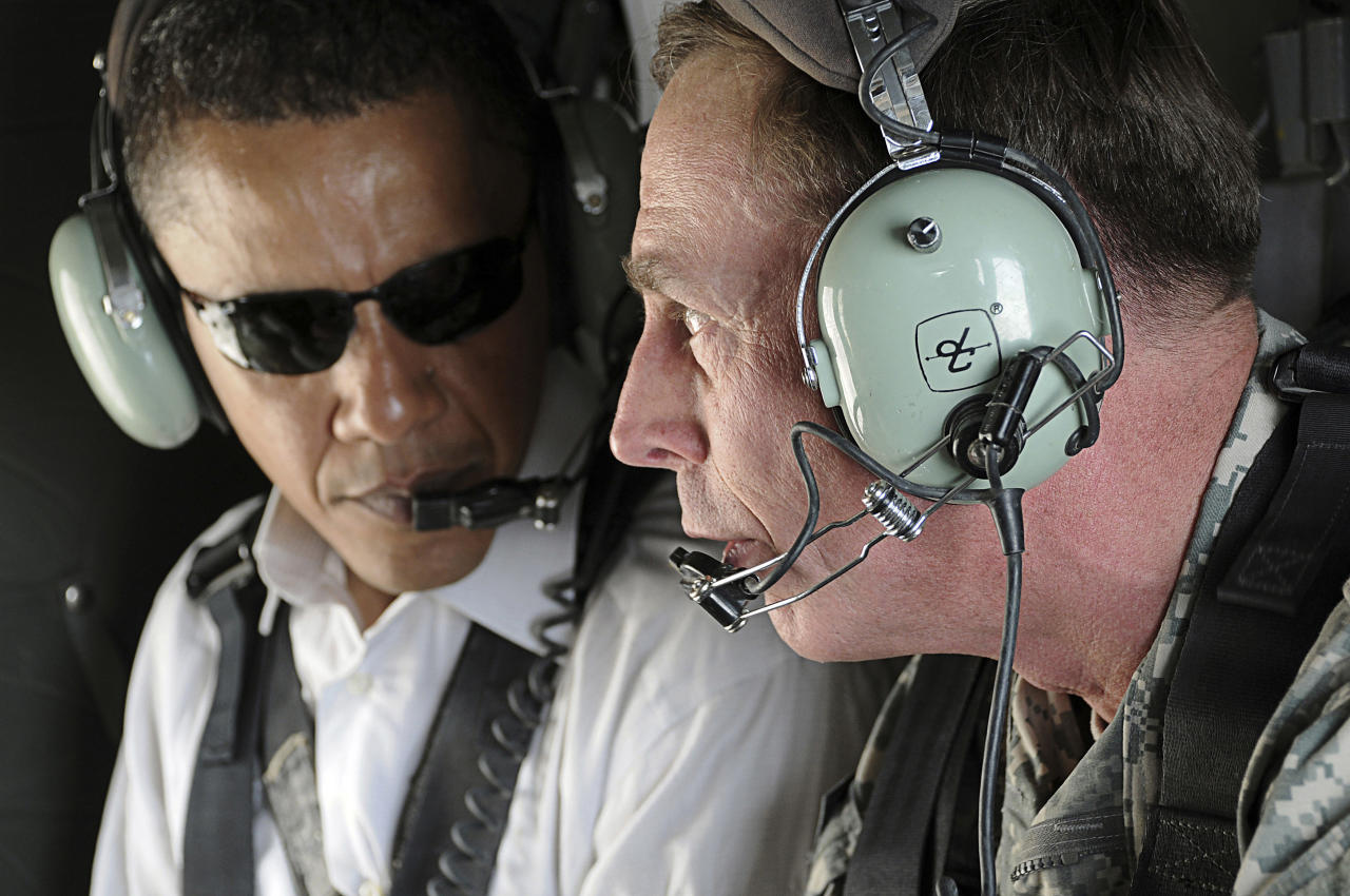 Then U.S. Senator Barack Obama  listens (L) as Gen. David Petraeus (R) discusses security improvements in Baghdad while giving him an aerial tour of the city, in this July 21, 2008 file photo. U.S. President Obama has chosen Petraeus to replace Gen. Stanley McChrystal as the top U.S. general in Afghanistan, the president announced on June 23, 2010. Picture taken July 21, 2008.  REUTERS/Lorie Jewell/Multi-National Forces Iraq Public Affairs/Handout