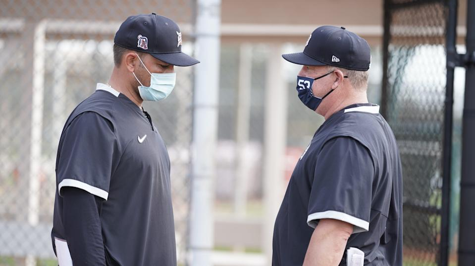 Detroit Tigers hitting coach Scott Coolbaugh (right) talks with assistant hitting coach Jose Cruz Jr. during spring training Feb. 18, 2021, in Lakeland, Florida.