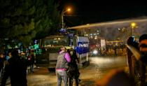 Georgia police use a water cannon to disperse demonstrators during an opposition rally in Tbilisi