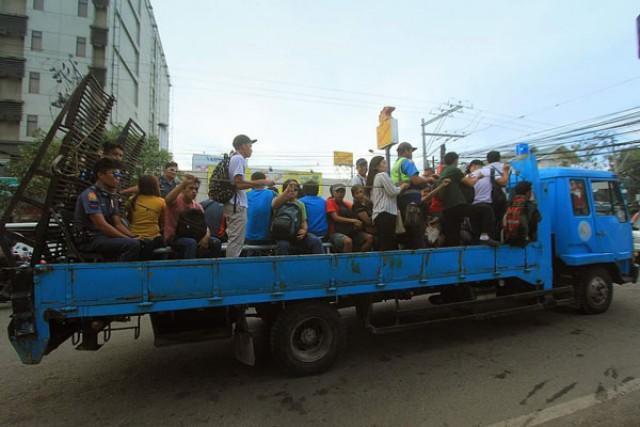 Stranded commuters picked up by trucks
