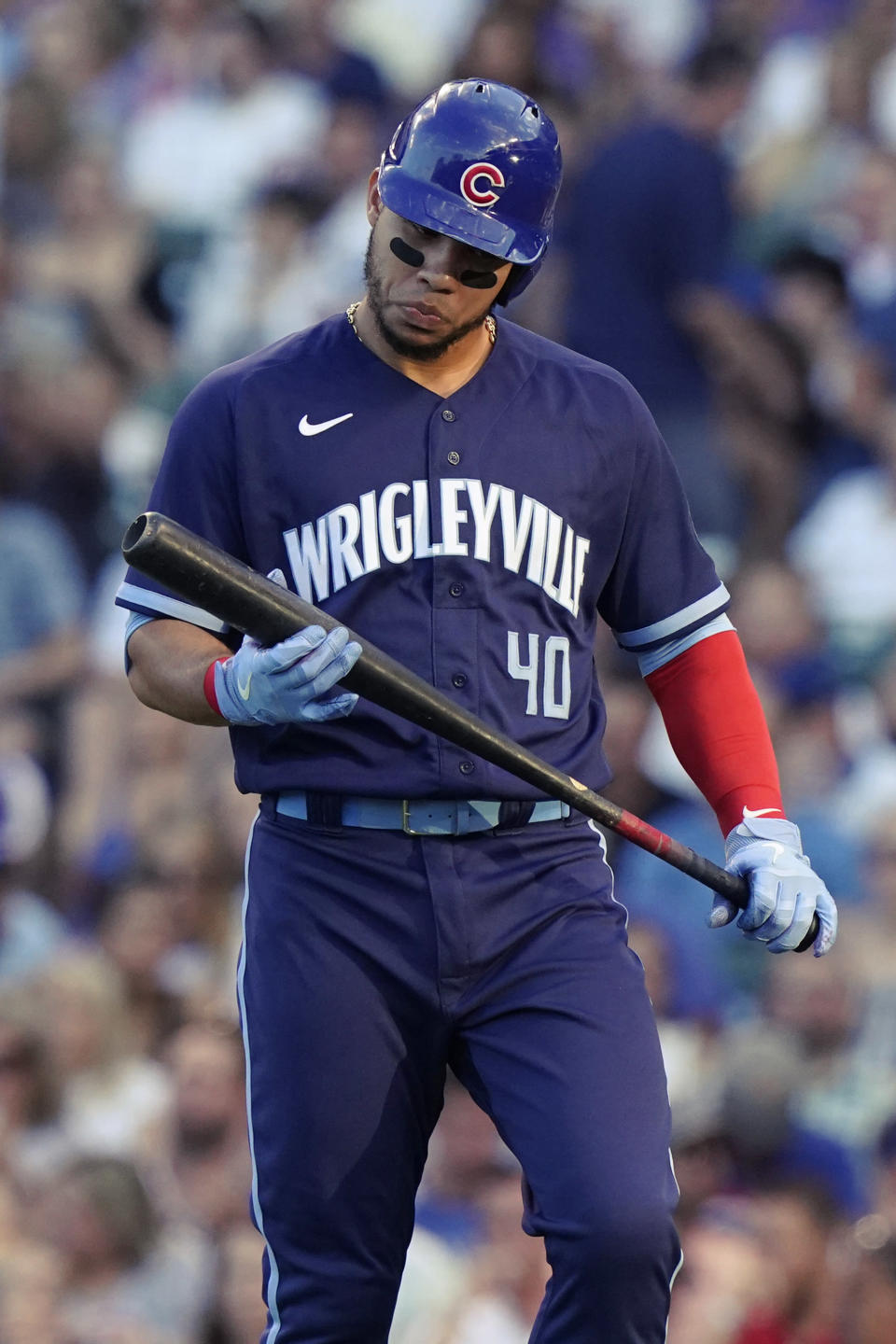 Chicago Cubs' Willson Contreras checks his bat after striking out swinging during the first inning of the team's baseball game against the Miami Marlins in Chicago, Friday, June 18, 2021. (AP Photo/Nam Y. Huh)