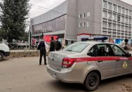 A car of Russia's National Guard is seen at the scene following a shooting at university in Perm