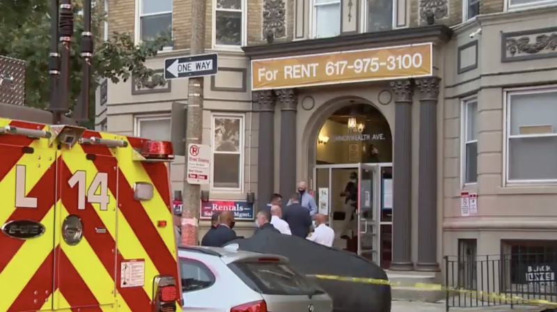 Photo shows the front of a woman's apartment where an elevator crushed and killed her.