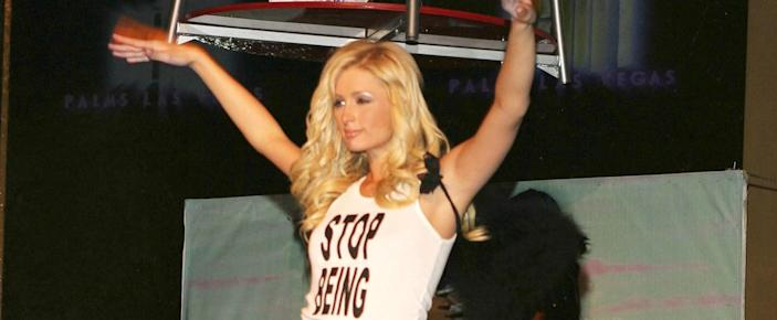 """Paris Hilton Debunks the """"Stop Being Poor"""" Tank Top - That's Not What It Actually Said!"""
