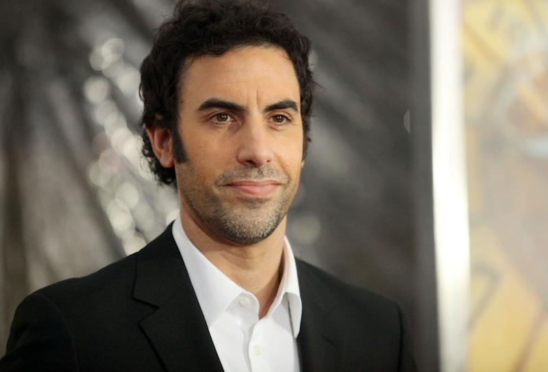Comedian Sacha Baron Cohen Trolls a Right-wing Rally With a Racist Sing-along