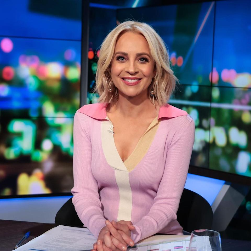 Carrie Bickmore on The Project set wearing a pink knit midi dress by designer REMAIN Birger Christensen
