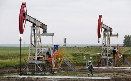 Pump jacks pump oil at oil field Buzovyazovskoye owned by Bashneft company north from Ufa