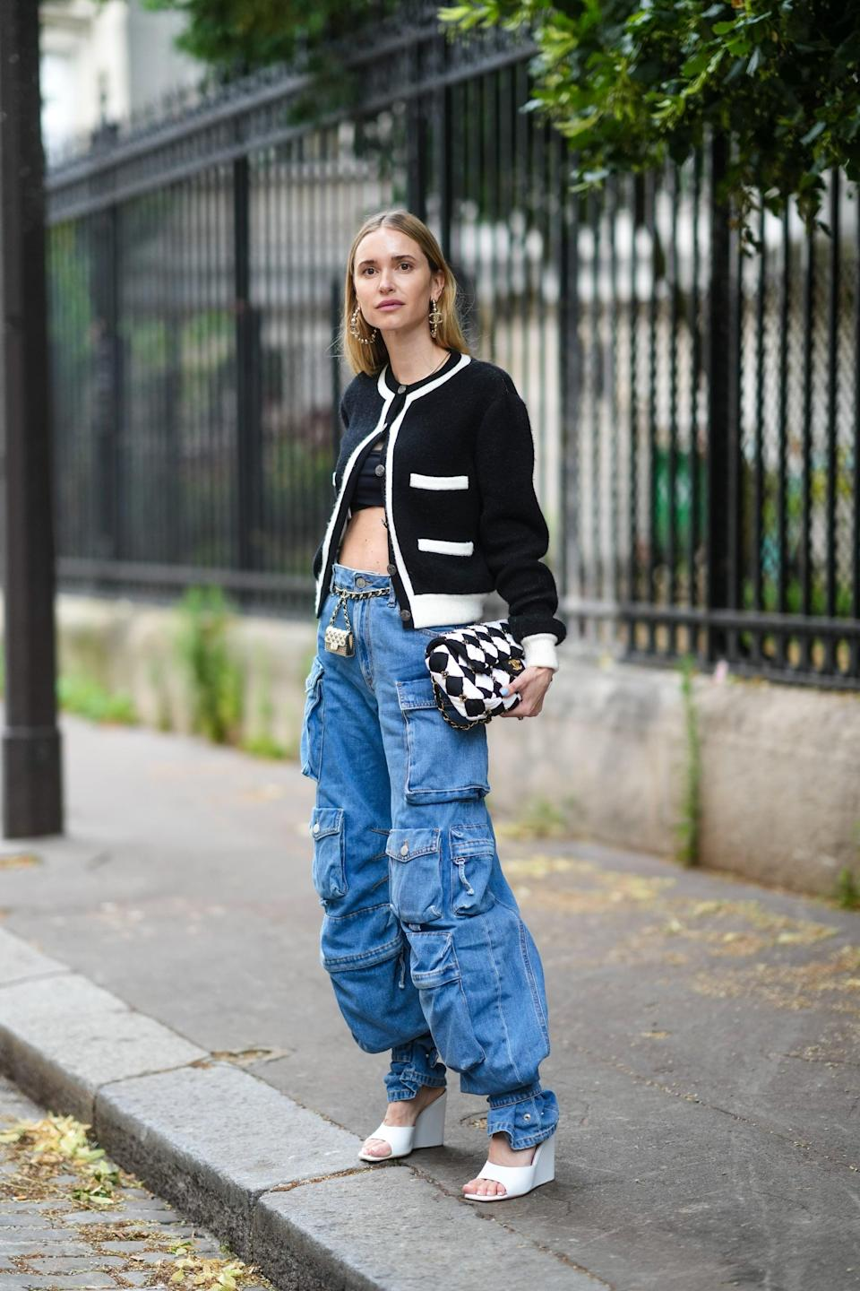 <p>Remix the sporty vibes of cargo jeans with heels and a sophisticated cardigan. </p>
