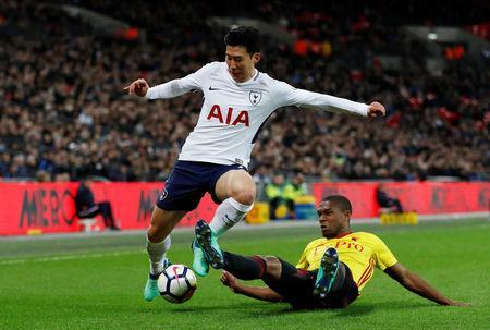 "Soccer Football - Premier League - Tottenham Hotspur v Watford - Wembley Stadium, London, Britain - April 30, 2018 Tottenham's Son Heung-min in action with Watford's Christian Kabasele Action Images via Reuters/Paul Childs EDITORIAL USE ONLY. No use with unauthorized audio, video, data, fixture lists, club/league logos or ""live"" services. Online in-match use limited to 75 images, no video emulation. No use in betting, games or single club/league/player publications. Please contact your account representative for further details."
