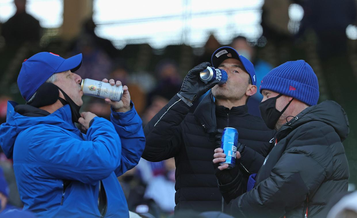 Fans drink beers during the Opening Day home game between the Chicago Cubs and the Pittsburgh Pirates at Wrigley Field on April 01, 2021 in Chicago, Illinois. (Jonathan Daniel/Getty Images)