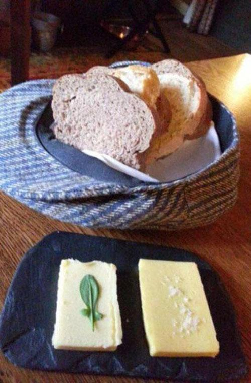 """How would you feel if your bread was delivered to your table in a hat? Was the waiter looking for new and clever ways to show off his jaunty hat-wear collection? Perhaps not. One man on Twitter declared """"Bring back the plates."""" #BreadHead"""