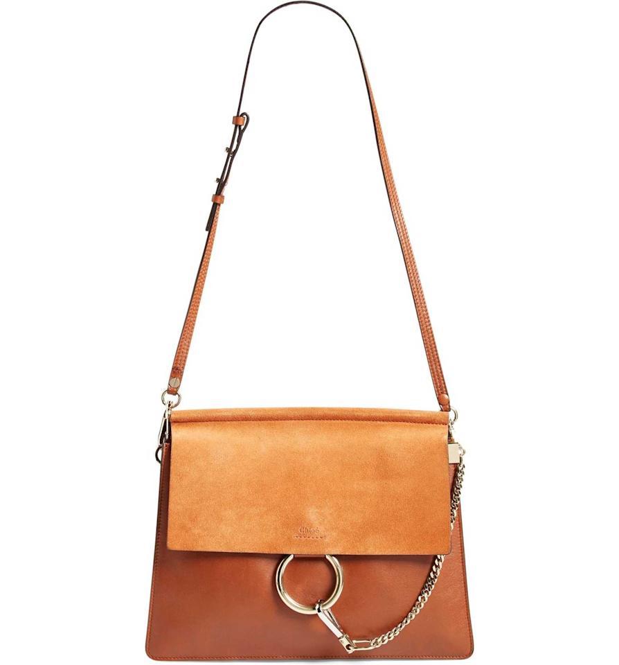 <p>Your outfit isn't complete without a good handbag, especially an expertly constructed leather option like this one. The best part about this handbag: You can wear it with just about anything.</p>