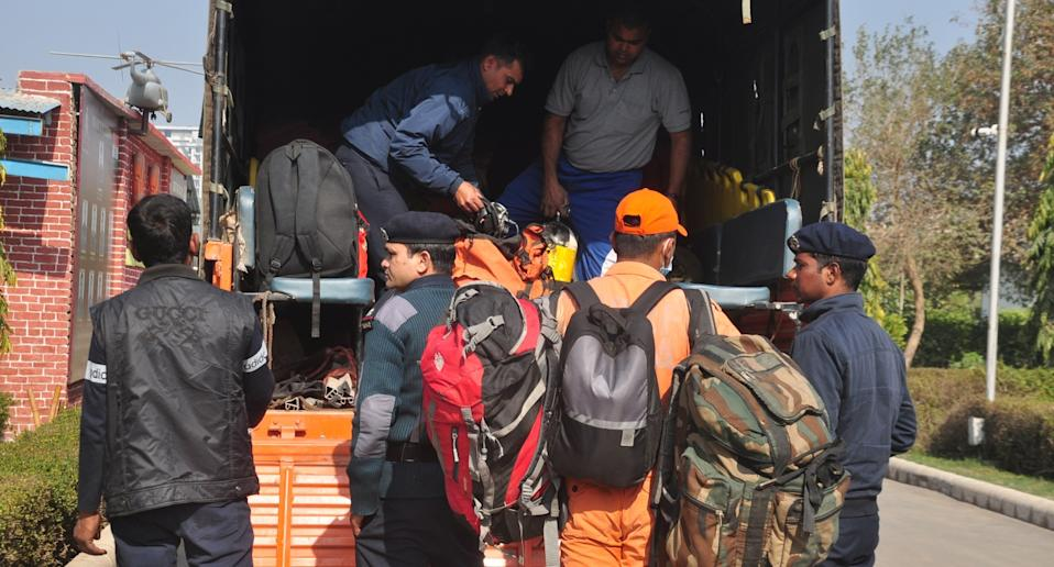 Teams from NDRF's 8th Battalion prepare before heading to Uttarakhand's Chamoli district where a flash flood occurred following a glacial burst on Sunday morning. Photo: Sakib Ali/Hindustan Times via Getty Images