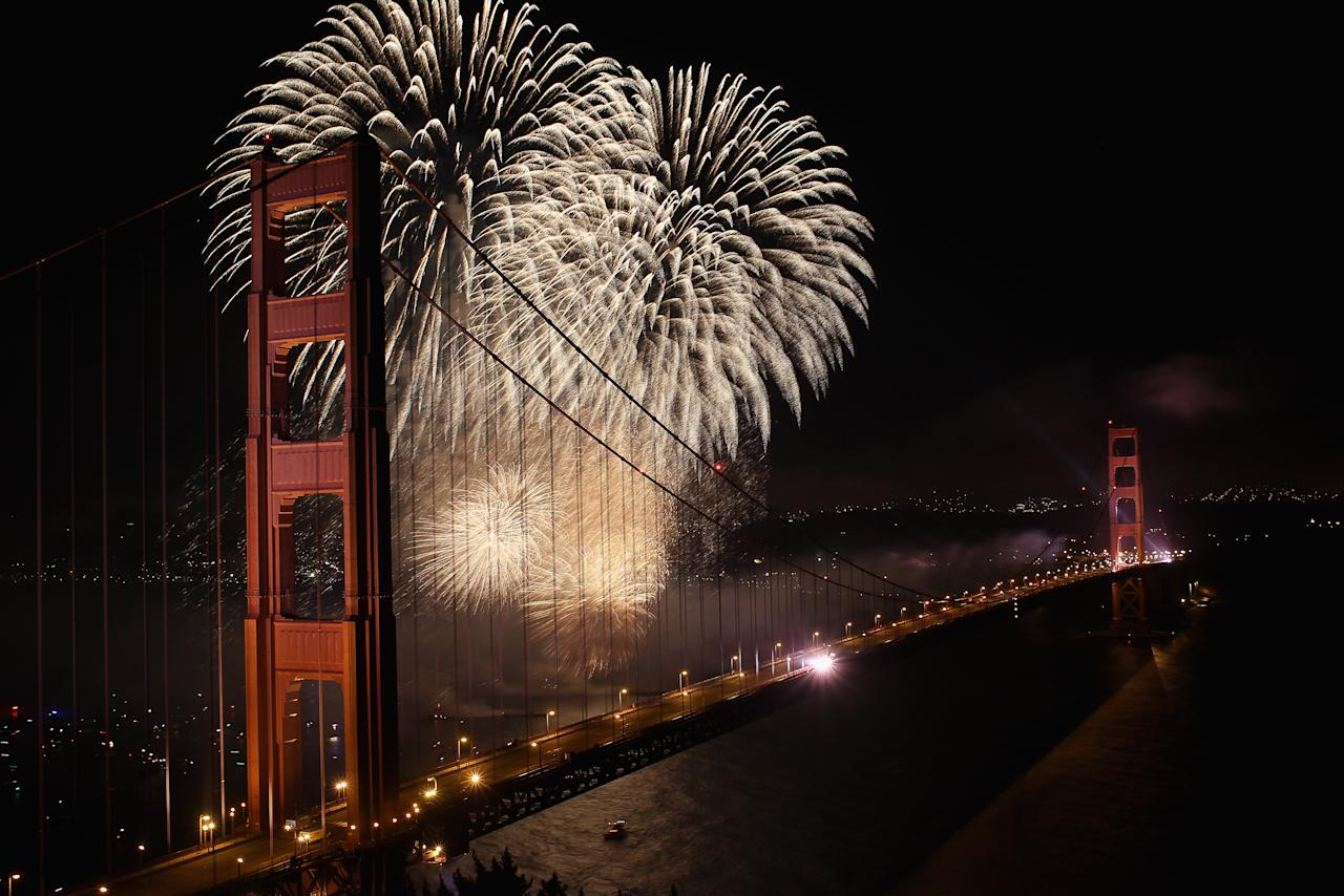 Fireworks explode over the Golden Gate Bridge on May 27, 2012 in San Francisco, California.  The Golden Gate Bridge celebrates its 75th anniversary today. The 1.7 mile steel suspension bridge, one of the modern Wonders of the World, opened to traffic on May 27, 1937.  (Photo by Ezra Shaw/Getty Images)