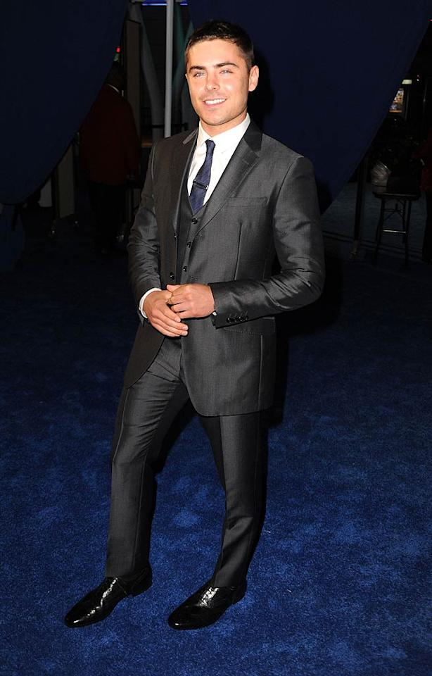 """""""Charlie St. Cloud"""" heartthrob Zac Efron (who was named Favorite Male Movie Star Under 25) looked a tad shiny from head to toe in a snug sharkskin suit. Jeff Kravitz/<a href=""""http://www.filmmagic.com/"""" target=""""new"""">FilmMagic.com</a> - January 5, 2011"""