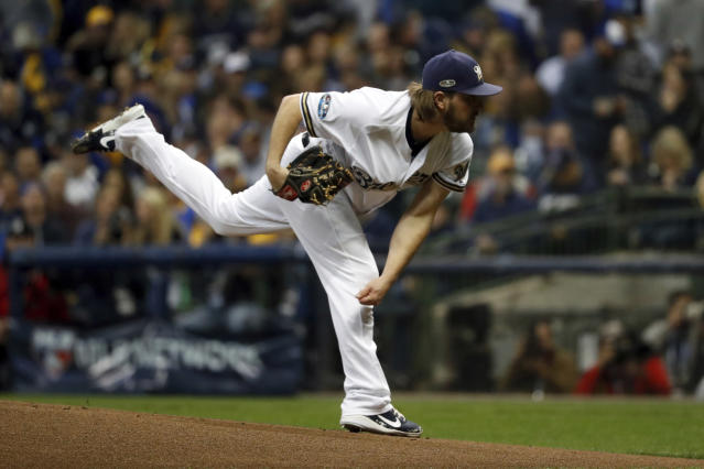 Milwaukee Brewers starting pitcher Wade Miley throws during the first inning of Game 6 of the National League Championship Series baseball game against the Los Angeles Dodgers Friday, Oct. 19, 2018, in Milwaukee. (AP Photo/Jeff Roberson)