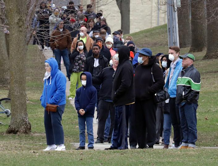 Long lines of people waiting to vote were seen along North Bartlett Avenue near East Riverside Place, a few block south of the polling location at Riverside High School in Milwaukee on Tuesday. The Wisconsin primary is being held in the midst of the coronavirus epidemic despite efforts by Gov. Tony Evers to shut down the election. Gov. Evers' actions were swiftly rejected by the conservative majority of the Wisconsin Supreme Court.
