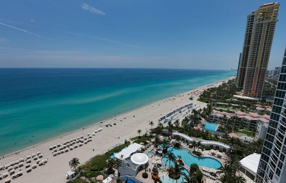 A general view from a balcony of the Trump Palace luxury condominiums on Sunny Isles Beach, Florida, on May 15, 2017. More than half, 54 percent, of Miami foreign real estate buyers come from Latin America, according to the National Association of Realtors. Another 18 percent are Europeans and 13 percent Canadians. A closer look at the figures show that Canadians were the top buyers of luxury apartments in 2016, followed by Venezuelans and Brazilians. / AFP PHOTO / RHONA WISE        (Photo credit should read RHONA WISE/AFP via Getty Images)