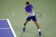 Novak Djokovic, of Serbia, prepares to hit a backhand to Matteo Berrettini, of Italy, during the quarterfinals of the U.S. Open tennis tournament Wednesday, Sept. 8, 2021, in New York. (AP Photo/Frank Franklin II)