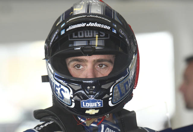 Driver Jimmie Johnson prepares for practice for Sunday's NASCAR Sprint Cup series auto race Friday, Nov. 15, 2013, at Homestead-Miami Speedway in Homestead, Fla.(AP Photo/David Graham)