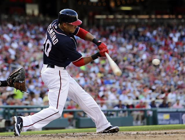 Washington Nationals' Ian Desmond hits a two-RBI double during the third inning of a baseball game against the San Francisco Giants at Nationals Park, Thursday, Aug. 15, 2013, in Washington. (AP Photo/Alex Brandon)