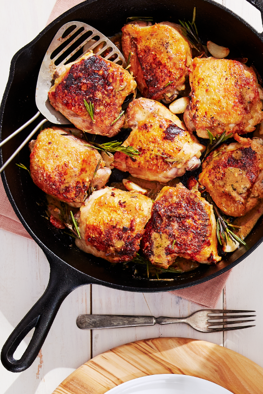 """<p>Your whole family will fall in love with these crispy chicken thighs (emphasis on """"crispy""""). Garlic and rosemary make them as aromatic as they are delicious. Serve with a fresh green salad for an extra touch of green.</p><p><strong><a href=""""https://www.countryliving.com/food-drinks/a28942039/crispy-chicken-thighs-with-garlic-and-rosemary-recipe/"""" rel=""""nofollow noopener"""" target=""""_blank"""" data-ylk=""""slk:Get the recipe"""" class=""""link rapid-noclick-resp"""">Get the recipe</a>.</strong> </p>"""